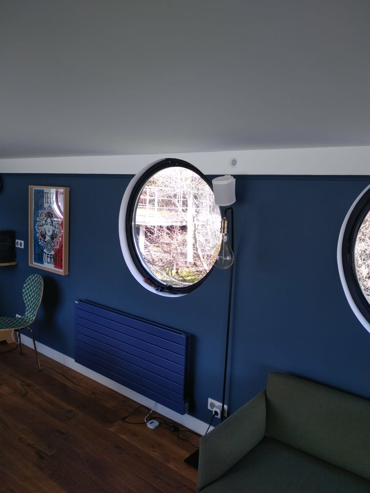 2 fixed portholes in blue wall