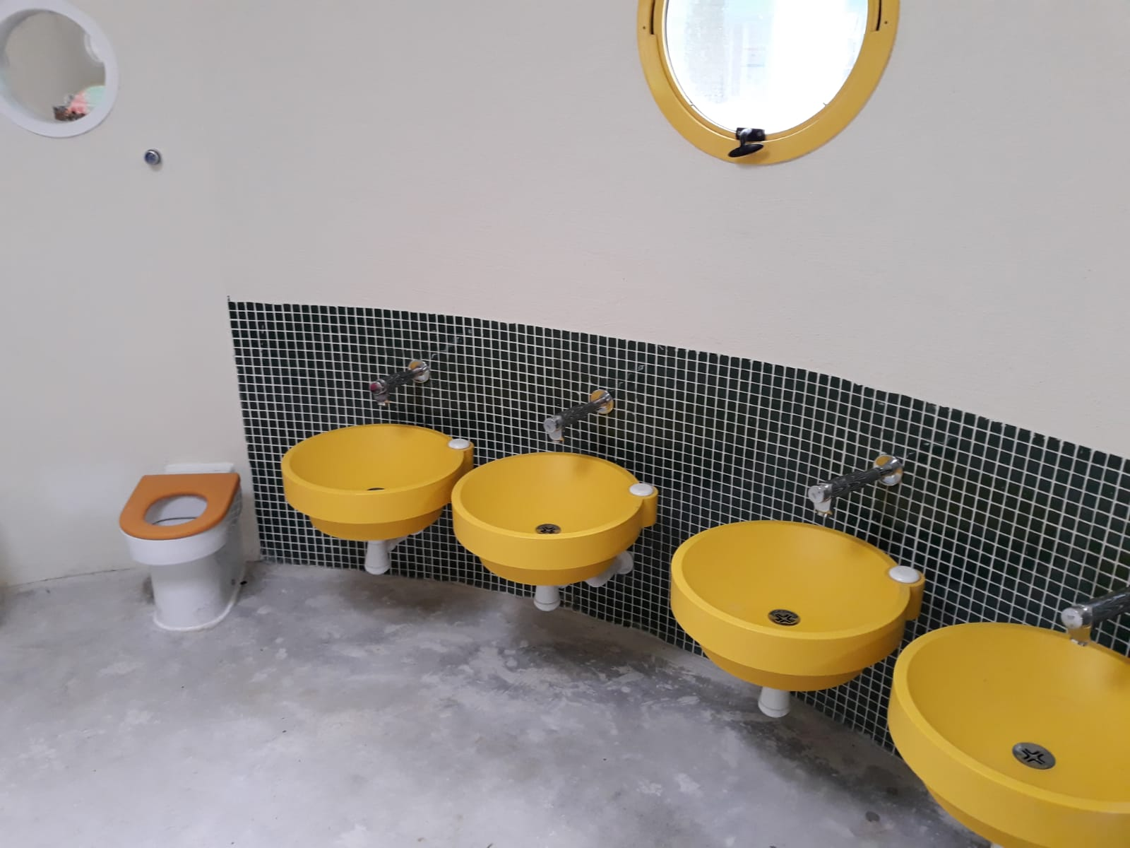 titlted portholes in bathroom